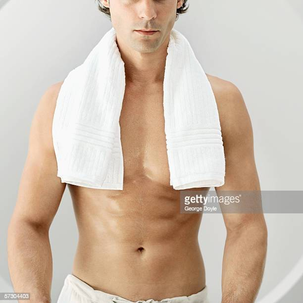 bare-chested young man with a towel around his neck