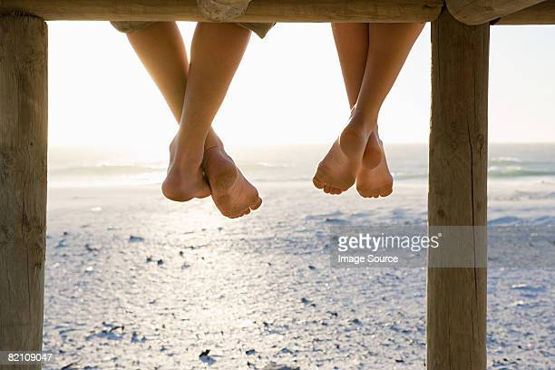 Barefeet and a pier