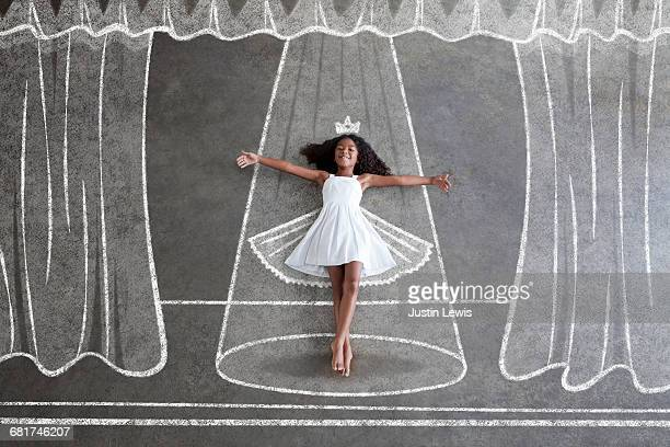 Barefoot black girl, imagines being ballerina
