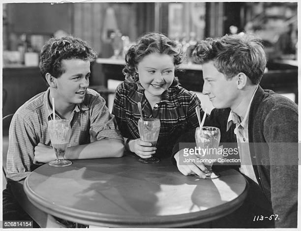 Barefoot Boy stars Jackie Moran Marcia Mae Jones and Bradley Metcalfe enjoy milk shakes at the soda fountain