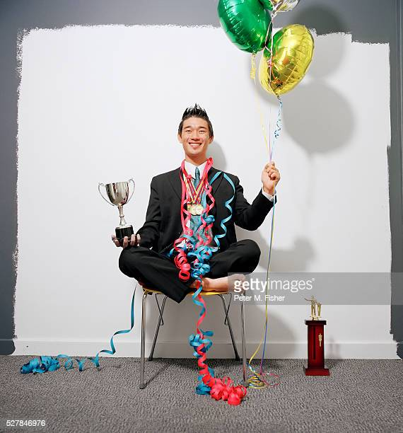 barefoot businessman celebrating achievements - medallist stock pictures, royalty-free photos & images
