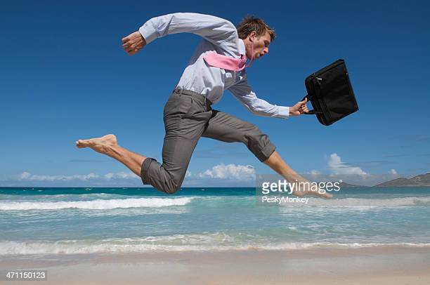Barefoot Businessman Rushes Past Beach with Briefcase