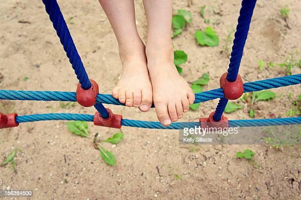 Barefoot climbing on a beach playground