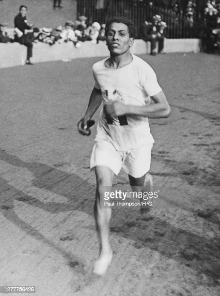 Barefoot competitor in the men's marathon race from Windsor to Stamford Bridge in London during the 1948 Summer Olympics, the XIVth Olympiad, 1948.