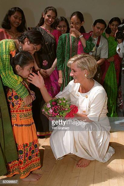Barefoot Diana Princess Of Wales Crouching Down To Stroke A Child's Face Whilst Visiting The Shri Swaminarayan Mandir In Neasden London