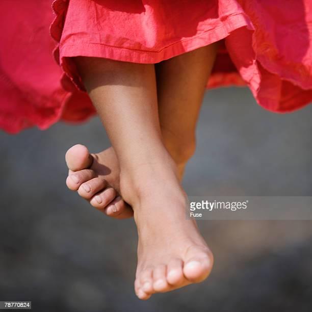 Barefoot Girl Sitting on Swing