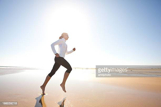 barefoot jog on wide sandy beach