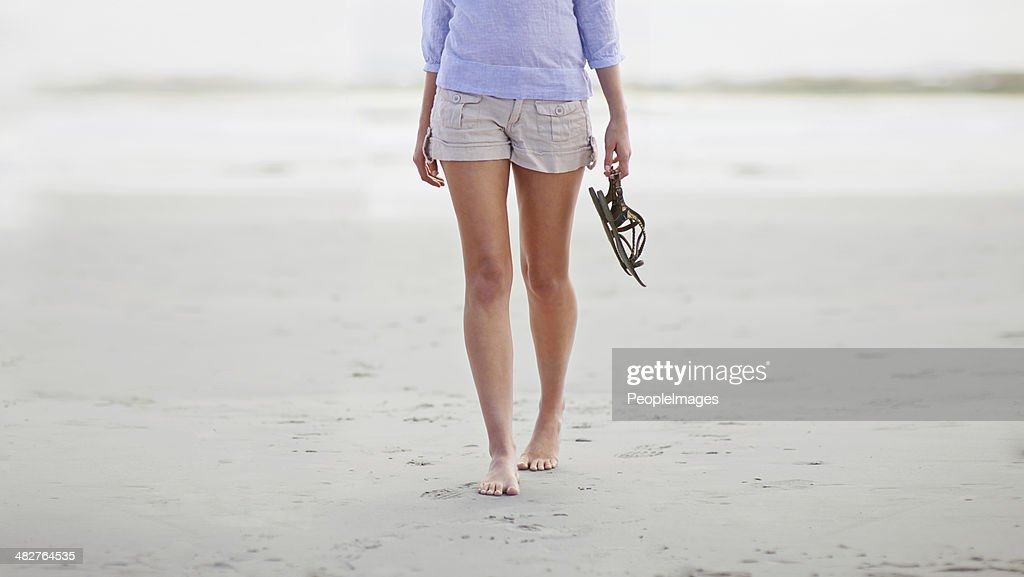 Barefoot on the beach : Stock Photo