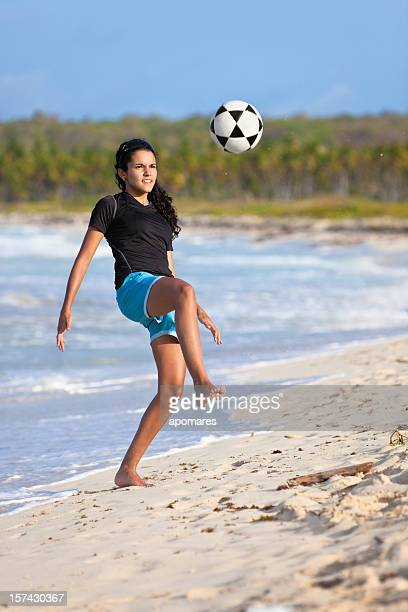 Barefoot soccer girl controlling the ball