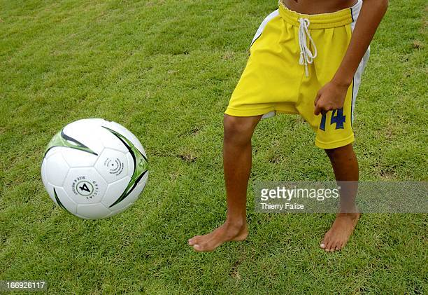 A barefoot student practices technical exercises during daily training