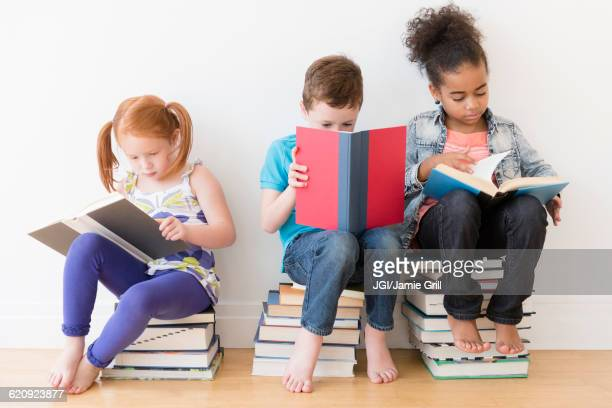 Barefoot students reading books