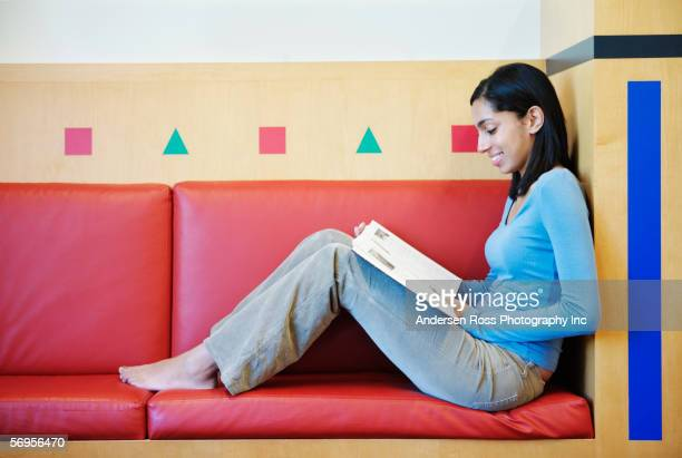 barefoot teenage girl reading - hot indian girls stock photos and pictures