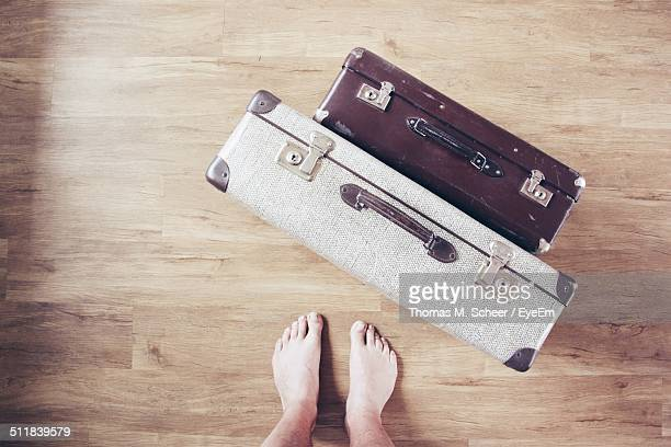 Barefoot with suitcases