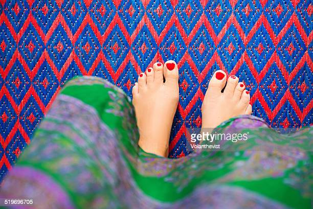 barefoot woman in a patterned carpet - foot worship stock pictures, royalty-free photos & images