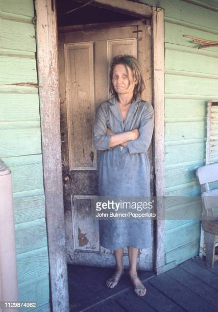 A barefoot woman on the porch of her house Pike County Kentucky US 1967