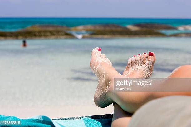 Barefoot Young Woman on Sandy Beach Lounge Chair in Tropics