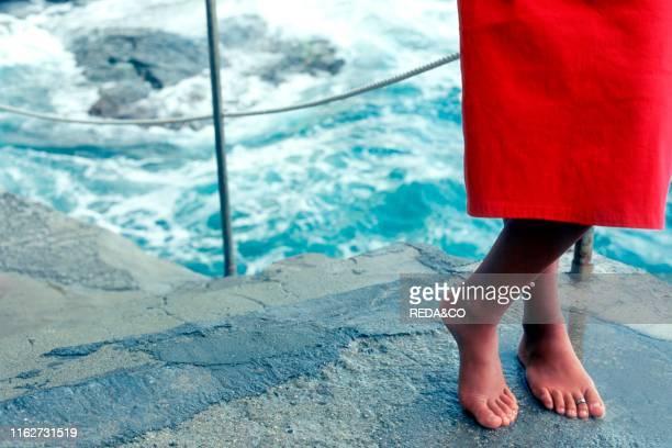 Barefooted woman. Ligury. Italy. Europe.