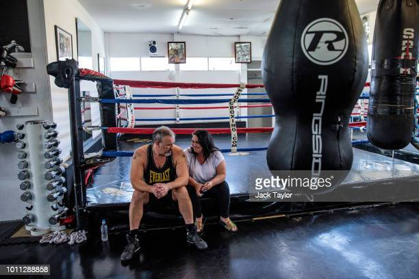 Bareknuckle boxing promoter and trainer Shaun Smith 52 sits with his wife and business partner Amanda Smith on the edge of a boxing ring after...