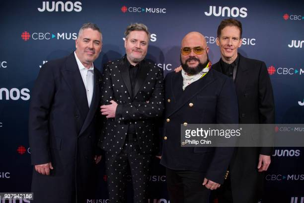 Barenaked Ladies members Ed Robertson Kevin Hearn Tyler Stewart and Andy Creeggan attend the red carpet arrivals at the 2018 Juno Awards at Rogers...