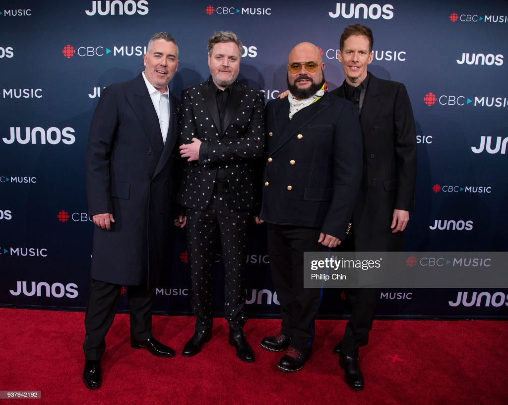 Barenaked Ladies members Ed Robertson, Kevin Hearn, Tyler Stewart and Andy Creeggan attend the red carpet arrivals at the 2018 Juno Awards at Rogers Arena on March 25, 2018 in Vancouver, Canada.
