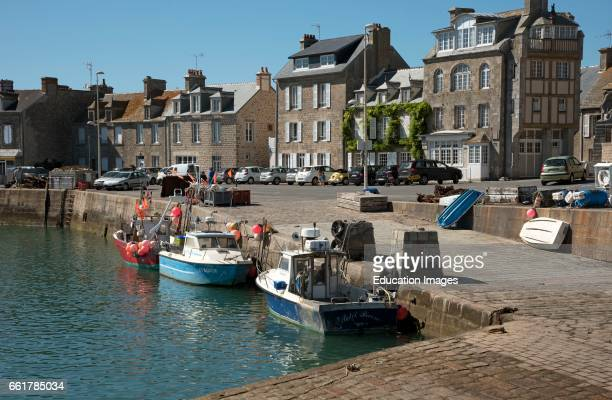 Barfleur a small French port in the Normandy region Boats on the quayside in the coastal commune of Barfleur in Normandy northwest France