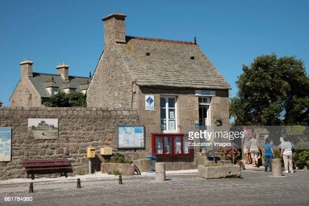 Barfleur a small French port in the Normandy region The tiny building which houses the Tourist Office on the quayside