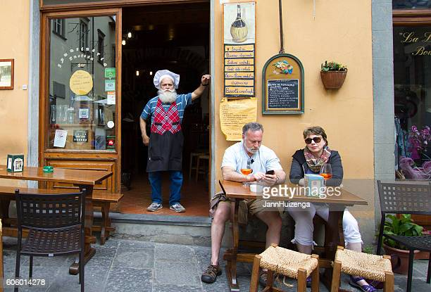 Barga, Tuscany: Tourists and Chef Outside Restaurant, Italy