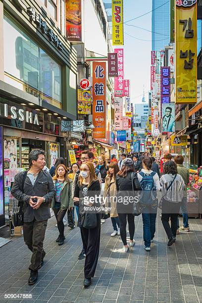 Bargain hunters in colourful crowded shopping street downtown Seoul Korea