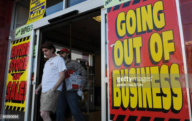 Bargain hunters leave an electrical store which is having a clearance sale before going out of business in Los Angeles on February 2 2009 President...