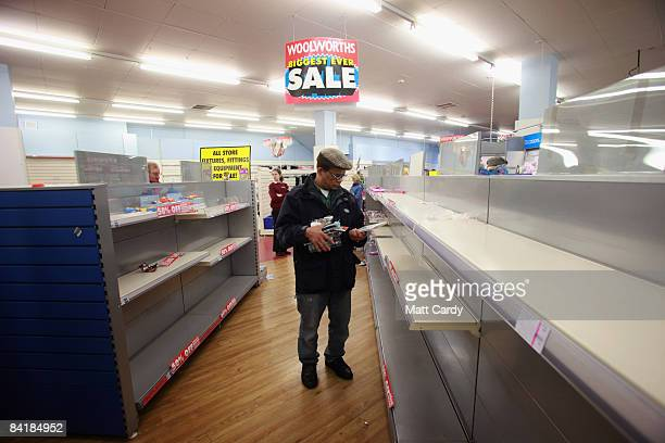 Bargain hunters look at the remaining stock in the Stroud branch of Woolworths just before it closed its doors for the final time on January 6 in...