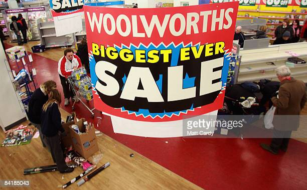 Bargain hunters look at the remaining stock in the Stroud branch of Woolworths just before it closed its doors for the final time on January 6in...