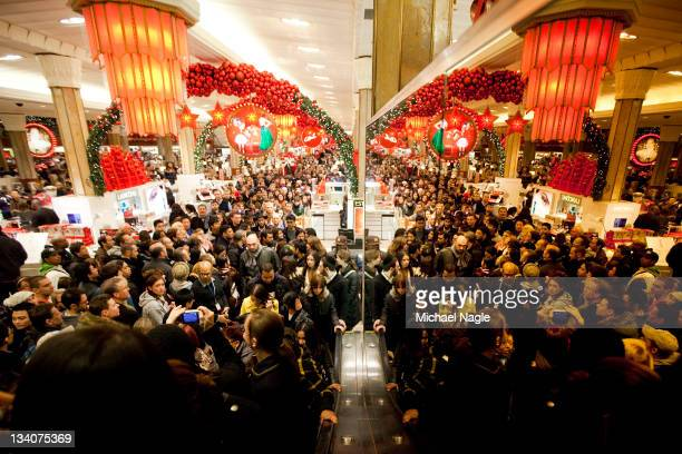 Bargain hunters shop for discounted merchandise at Macy's on 'Black Friday' on November 25 2011 in New York City Marking the start of the holiday...