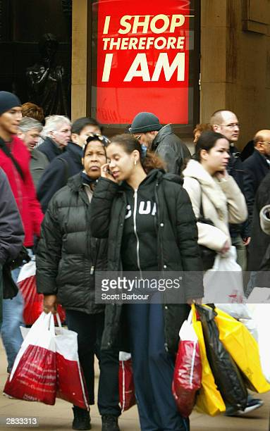 Bargain hunters shop on Oxford Street on December 27 2003 in London The winter sales usually begin after Christmas Day although this year many shops...