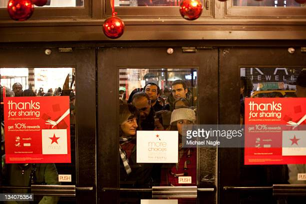 Bargain hunters wait in line outside Macy's shortly before 'Black Friday' begins on November 24 2011 in New York City Marking the start of the...