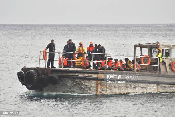 A barge carrying rescued suspected asylum seekers nears Christmas Island on June 22 2012 on Christmas Island Rescuers are searching for survivors off...