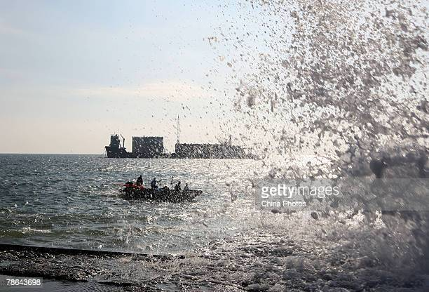 """Barge carrying the wreck of the 800-year-old sunken merchant ship """"Nanhai No.1"""" , prepares to berth on a temporary dock on the South China Sea on..."""