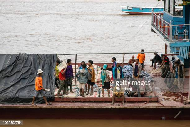 A barge delivers construction materials to a dock near the Luang Prabang railway bridge a section of the ChinaLaos Railway built by the China Railway...