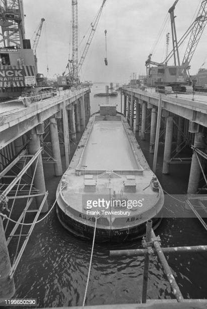 A barge during construction of the Thames Flood Barrier on the River Thames London August 1976