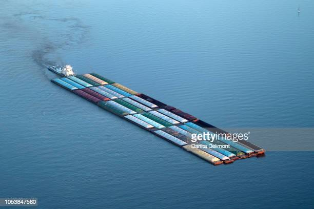 barge filled with containers on mississippi river, usa - barge stock photos and pictures
