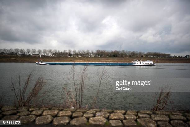 A barge is sailed along the Meuse river on February 21 2017 in Venlo Netherlands The Dutch will vote in parliamentary elections on March 15 in a...