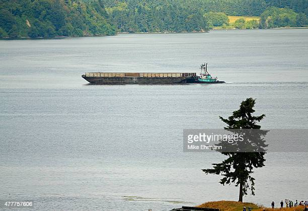 A barge is seen in the Puget Sound off the 16th hole during the second round of the 115th US Open Championship at Chambers Bay on June 19 2015 in...