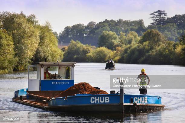 Barge loaded with aggregates leaving the Ripple Quarry Dock on the River Severn Gloucestershire UK.