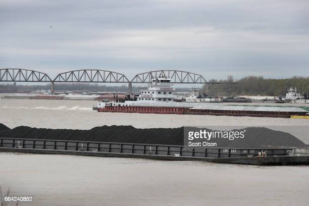 Barge loaded with Illinois Basin coal sits in the Ohio River on April 3, 2017 at Cairo, Illinois. President Donald Trump recently signed an executive...