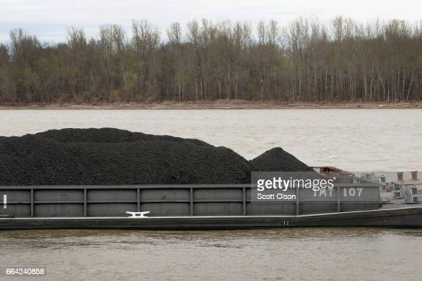 A barge loaded with Illinois Basin coal sits in the Ohio River on April 3 2017 at Cairo Illinois President Donald Trump recently signed an executive...