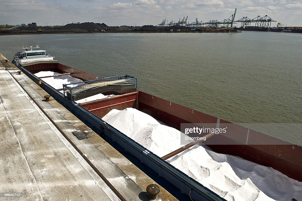 A barge loaded with salt from Germany lies at the quayside of the Solvay SA chemical plant in Antwerp, Belgium, on Thursday, April 22, 2010. Confidence within Europe�s chemical industry has risen for the first time in 21 months, ICIS news reported, citing data from the European Chemical Industry Council. Photographer: Jock Fistick/Bloomberg via Getty Images