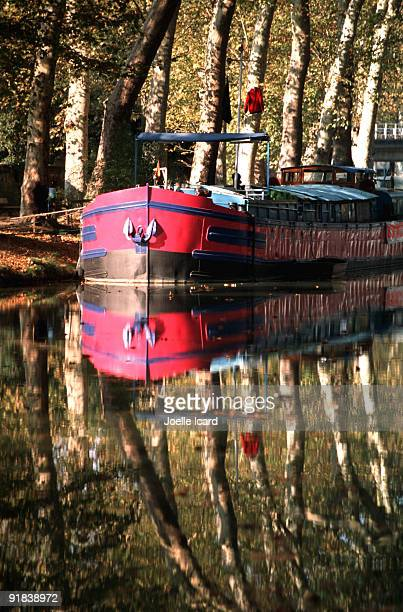 Barge on placid canal, Midi-Pyrenees, France