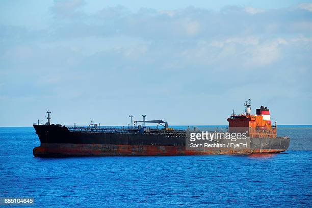 barge on sea against sky - barge stock photos and pictures