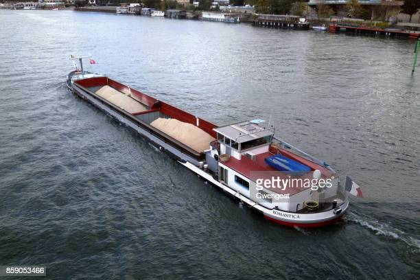 barge on the seine river - barge stock photos and pictures