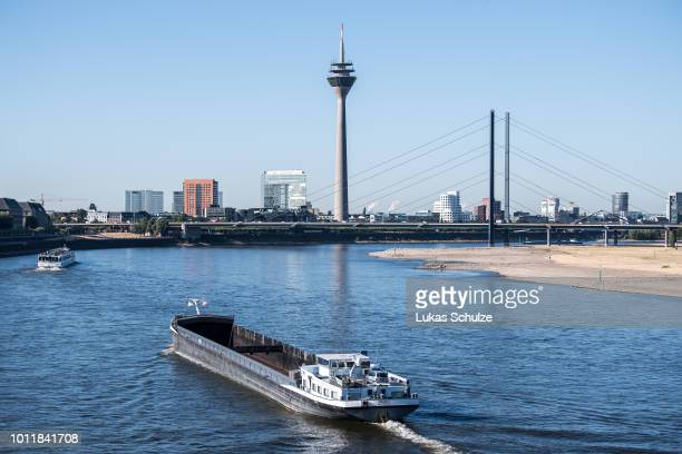 A barge sails on the river Rhine on a searing hot day on August 6 2018 in Duesseldorf Germany Due to the continuing drought and Low water levels...