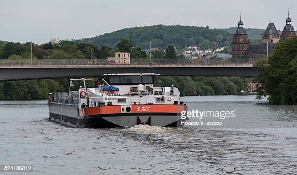 A barge sails the Main river near Schloss Johannisburg in Aschaffenburg Germany 14 May 2015 one of the most important buildings of the Renaissance...
